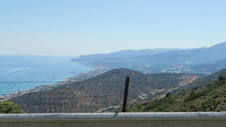 malia : View to bay of Malia (Crete Greece). Driving along a road train in the mountains. Stock Footage