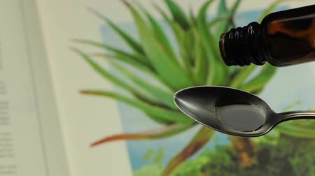bitkisel ilaç : Tincture drops falling on a spoon