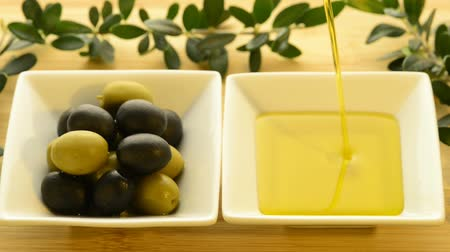 ramos : olive oil running into a bowl