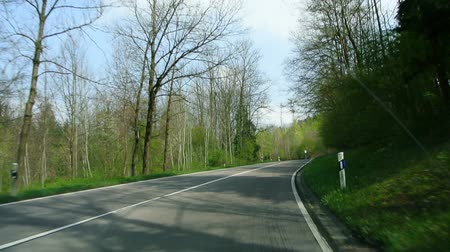 viagem por estrada : German forest in spring, driving on a road Stock Footage