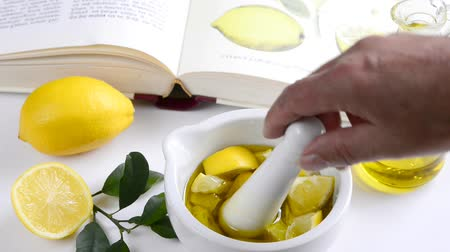 herbal : Preparing lemon oil in a mortar