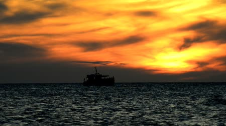 dalgakıran : Sunset over the Baltic Sea with boat