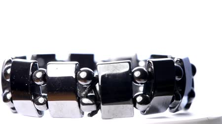 esotericism : Hematite bracelet on a turn table Stock Footage