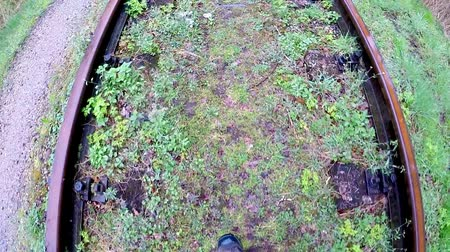 trackage : walking on an old closed railway on a rainy day in a forest in Poland