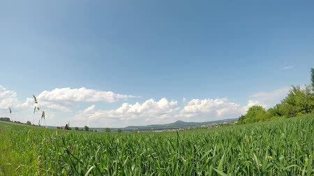 mozgás : Clouds in a time lapse in Germany with famous hill Hohenstaufen. former seat of emperor Barbarossa