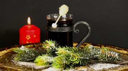 citron : burning candle and hot red wine punch on turn table