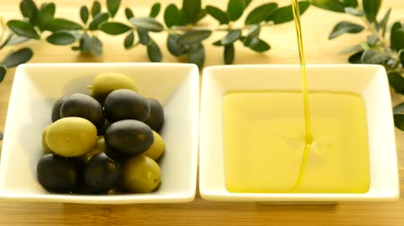 sto : Olive tree and olive oil running into a bowl