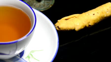 infusion : ginseng, root and tea on a turn table Stock Footage