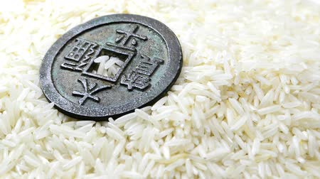 sponka : rice with antique chinese coin on turn table