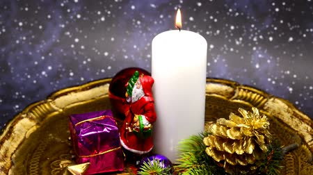 ziyafet : Christmas decoration with Santa Claus and candle light on turn table