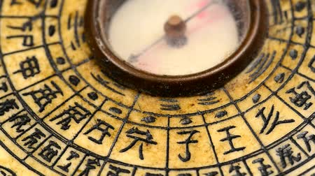 yin and yang : Antique Chinese Feng Shui compass on turn table