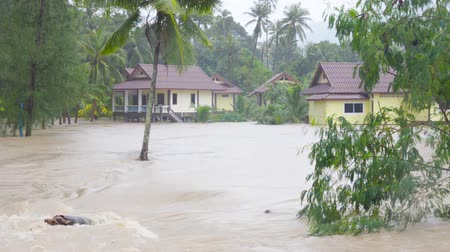 floods : Street under flood in Koh Phangan, Thailand.