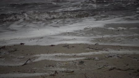 drenar : Dirty foam on the water and the seashore, eutrophication, pollution of the reservoir, ecological problem. Water pollution. Sewage, dirty, polluted water on a beach Stock Footage
