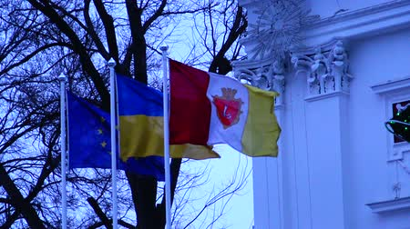 greece flag : Flag of the city of Odessa, Ukraine and the European Union, waving in the wind in Odessa Stock Footage