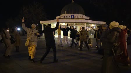 tanítvány : UKRAINE, Odessa - 29 December 2017: People from the Hare Krishna movement dancing and singing on the street. Krishnas dance on the streets of Odessa, a religious festival, Ukraine