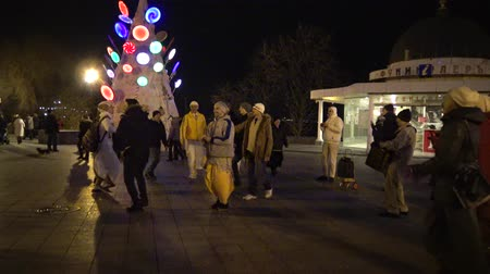 chant : UKRAINE, Odessa - 29 December 2017: People from the Hare Krishna movement dancing and singing on the street. Krishnas dance on the streets of Odessa, a religious festival, Ukraine