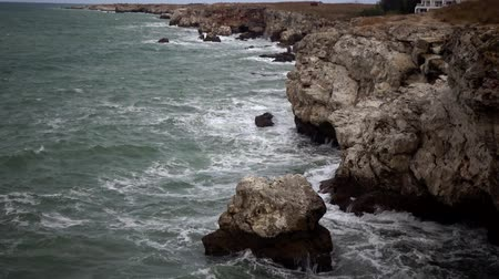 bad ecology : A strong storm on the sea at the precipitous shore, waves break against stones, white foam. Bulgaria