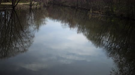 refletindo : Reflection of the clouds in the water on Lake Karnegy, NJ USA