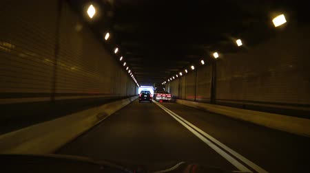 road sign : Tunnel in the Kittatinny mountain, video from the car, Pennsylvania Turnpike, USA