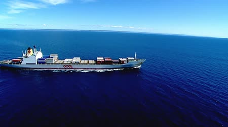 shipping : Aerial of Ocean going cargo container ship in blue sea underway
