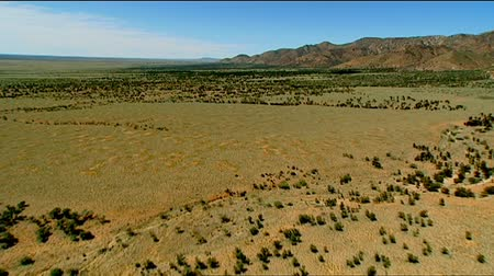 marys : Aerial footage of flat dry country and rugged out back Australian mountain ranges, peaks, desert and Mallee areas. Flinders Ranges Area, featuring Wilpena Pound