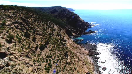 dağ geçidi : Aerial video footage and low fly pass of high cliffs, rocky coastlines, cliff tops and high seaside coastal mountain ranges. Good motion 3D tracking scenes. Betacam 16:9 wide screen converted.