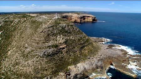 dağ geçidi : Light house aerial video footage and low fly pass of remarkable rocks, rocky coastlines, cliff tops and high seaside coastal mountain ranges. Good motion 3D tracking scenes. Betacam 16:9 wide screen converted.