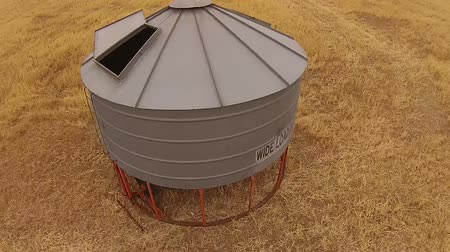 slashing : Aerial footage of farm with silo getting ready to harvest crop