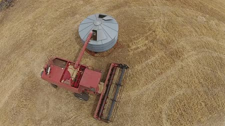slashing : Aerial footage of silo being filled with grain in rural Australia