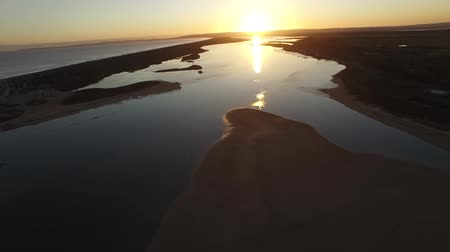 vizes élőhelyek : Aerial footage images and elevated view on sunset of river murray mouth in coorong and lower lakes on dusk. Famous place for coorong sandhills, sand dunes, wetlands, fishing and and boating in South Australia