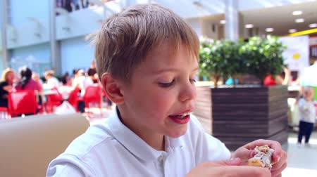 meal : the child eats a chicken in a fast food Stock Footage