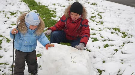 mittens : happy children play with snow in Park