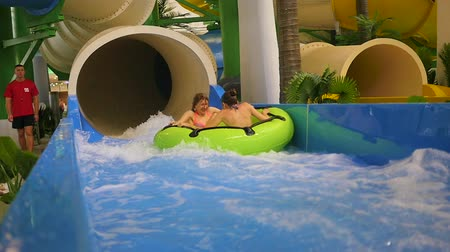 slayt : NOVOSIBIRSK,RUSSIA - November 01,2016:family having fun in water Park attraction