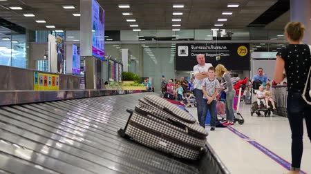 reclaim : BANGKOK, THAILAND - March 19,2017: people stand in the baggage claim area in the airport