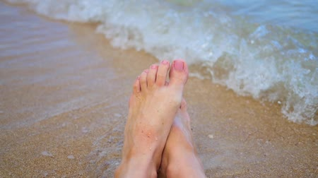 hobo : womens feet splashing in sea water on the beach.Closeup Stock Footage