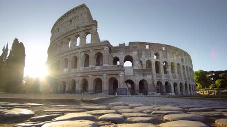 roma : Colosseum in Rome and morning sun, Italy
