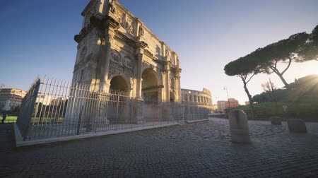 colloseum : Colosseum and Constantine arch at sunrise in Rome, Italy