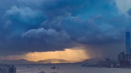 ciclone : Victoria harbor of Hong Kong Island with sunny stormy sky, China