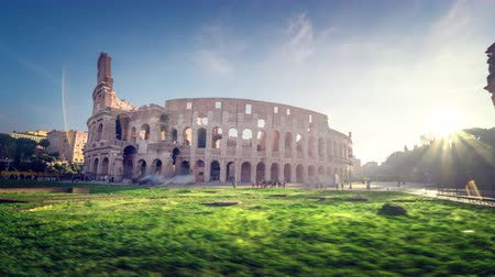 colloseum : hyper lapse, Colosseum and Constantine arch at sunrise in Rome, Italy