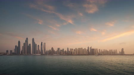 Объединенные Арабские Эмираты : timelapse of skyscrapers in Dubai Marina, sunset time, UAE