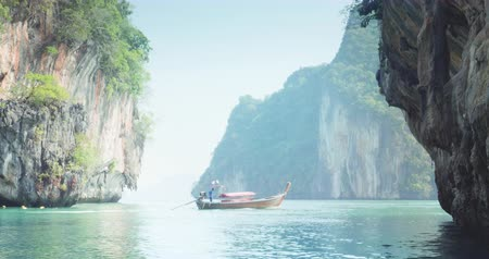 cauda : long boat and small Koh Lao Lading island, Thailand