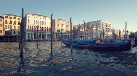 адриатический : gondolas in Venice, Italy, sunset time