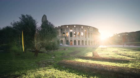 colosseo : Colosseum in Rome and morning sun, Italy