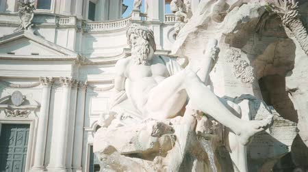 obelisk : Statue of Zeus in Berninis fountain of Four Rivers in Piazza Navona, Rome