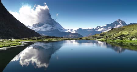 Reflection of Matterhorn in lake Riffelsee, Zermatt, Switzerland 動画素材