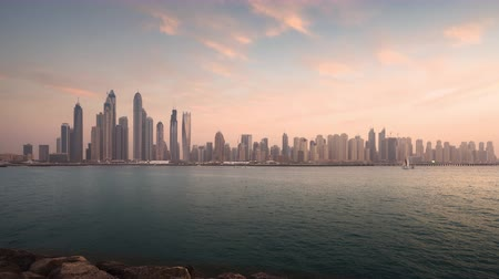 timelapse of skyscrapers in Dubai Marina, sunset time, UAE