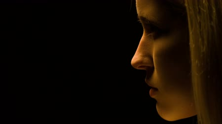 perfil : Part of face with no make-up isolated on black Stock Footage