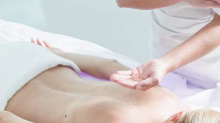 Skillful beautician preparing human body for massage Stok Video