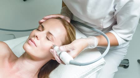 Calm lady having facial skin rejuvenation procedure