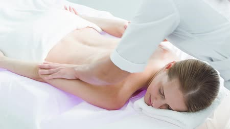 Calm lady enjoying body massage at spa Stok Video